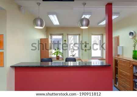 Reception desk in small medical clinic, horizontal - stock photo