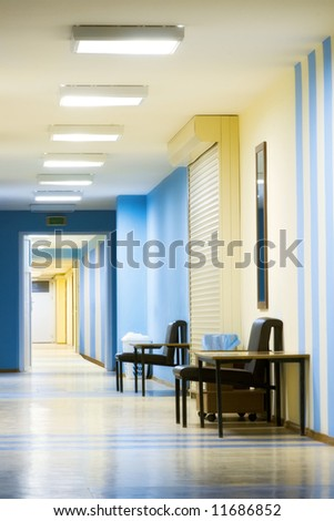 reception in hospital with corridor at evening time - stock photo
