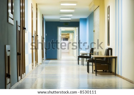 reception in hospital with corridor at night. - stock photo