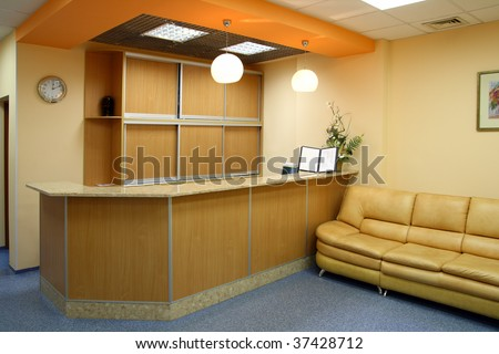 reception room interior with counter and sofa - stock photo
