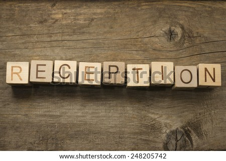 Reception text on a wooden background - stock photo