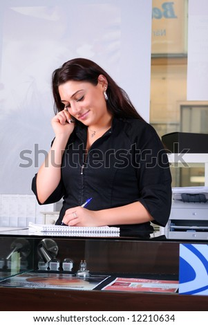 Receptionist taking a note - stock photo