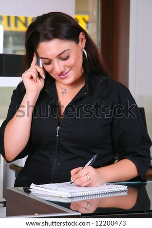 Receptionist taking note - stock photo
