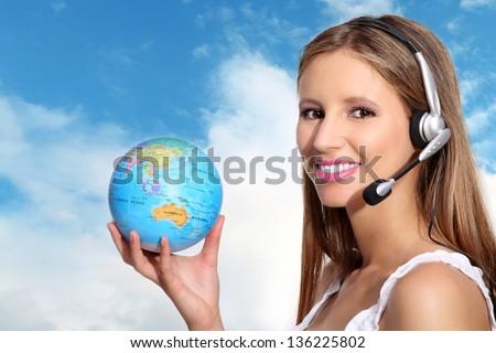 receptionist with headphones and globe - stock photo