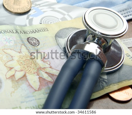 Recession concept: money and a stethoscope. Close up shoot. - stock photo