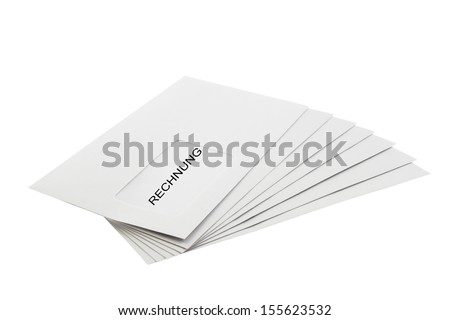 Rechnung (German Invoice) written on a Batch of Envelopes isolated on White Background