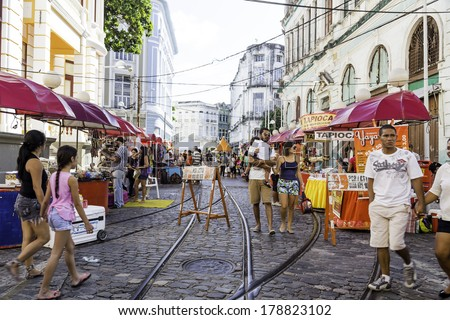 RECIFE, BRAZIL - CIRCA JANUARY 2014: People enjoy a local market on the street in the downtown of Recife, Pernambuco  - stock photo