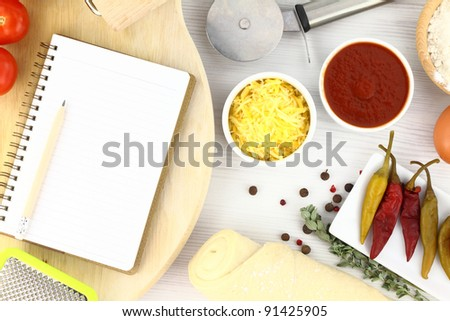 Recipe book for pizza - stock photo