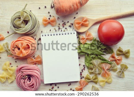 recipe book,vegetables(carrots, spinach, tomato) raw colored paste - stock photo