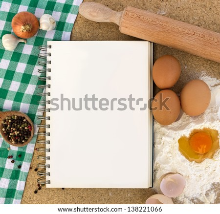Recipe book with basic ingredients for baking - stock photo