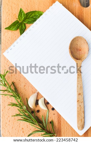 Recipe concept. Blank sheet of paper on a wooden board with spices - stock photo