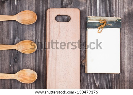Recipe cook book, kitchen equipment on wood background - stock photo