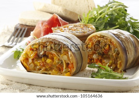 Recipe of aubergine rolls with vegetables and ham