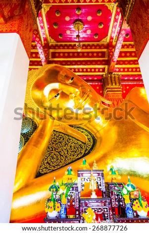 Reclining Buddha at Pamok Temple, Thailand. - stock photo