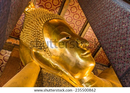 Reclining Buddha gold statue ,Wat Pho, Bangkok, Thailand, They are public domain or treasure of Buddhism, no restrict in copy or use  - stock photo