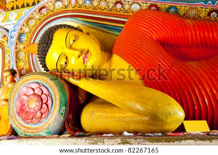reclining buddha in isurumuniya temple, anuradhapura, sri lanka - stock photo