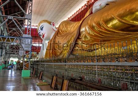 Reclining Buddha in Myanmar - stock photo