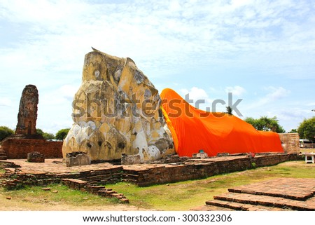 Reclining Buddha of Wat Lokaya Sutha in Ayutthaya, Thailand. - stock photo