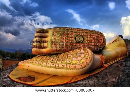 reclining buddha of wat ph-ra that su- thon mongkhon khiri samakkhi tham in thailand - stock photo