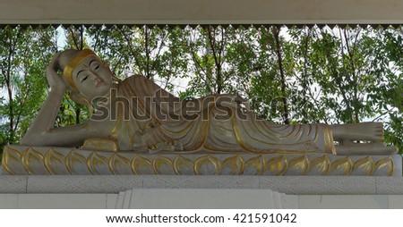 reclining buddha statue, in mendut buddhist monastery - stock photo