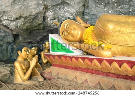 Reclining Buddha statue in the Elephant Cave ( Tham Sang ) near Vang Vieng - Exploring Lao PDR on exclusive destination - Day excursion around the sightseeing beauties of north of Laos - stock photo