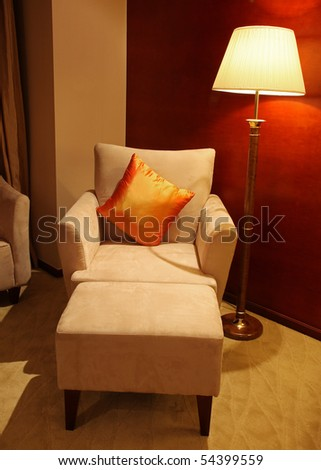 Reclining chair and night stand lamp - stock photo