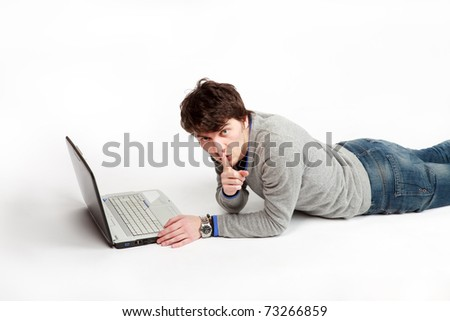 reclining man who orders to be quiet - stock photo