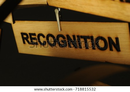 RECOGNITION on a wooden sign, photograph Aspirations word