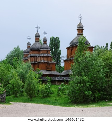 Reconstruction of an ancient wooden church in open air museum, Kiev, Ukraine - stock photo