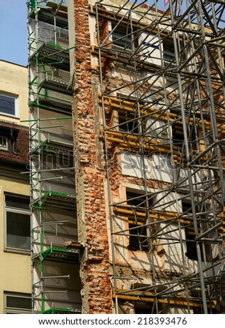 Reconstruction of old building with scaffolding undergoing repair-, Munich, Germany - stock photo