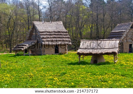 reconstruction of old historic huts - stock photo