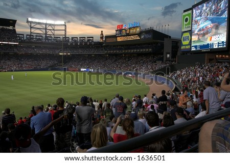 record crowd at Turner Field watches Nascar Cars go by in the outfield - stock photo
