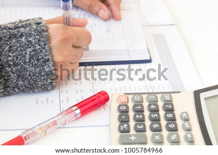 record expense income and financial statement yearly balance sheet with hand of woman working at office desk
