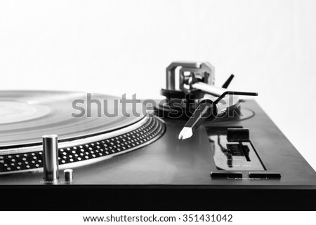 Record player arm with record - stock photo