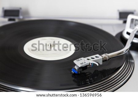 Record Player Playing Vinyl - stock photo