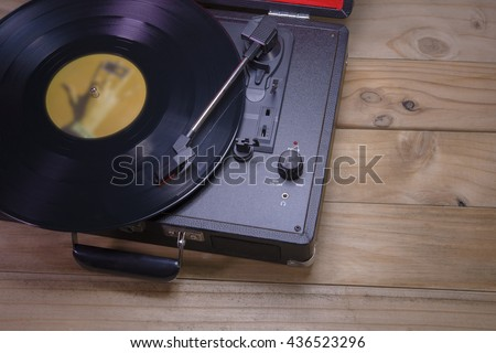Record player stylus on old wooden - stock photo