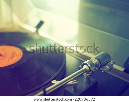 record vinyl on turntable in vintage color tone  - stock photo