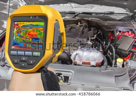 Recording Car Engine With Thermal Camera - stock photo