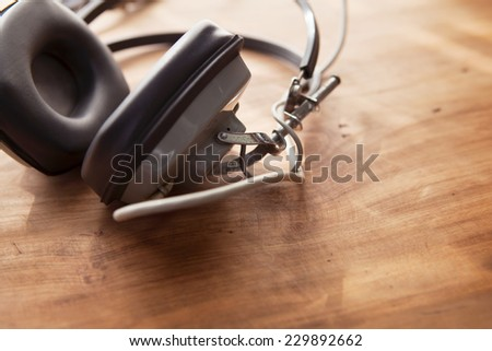 Recording scene. Headphones on a wooden desk