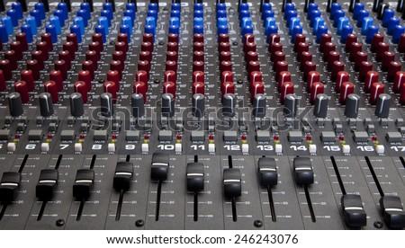 Recording studio audio mixing desk knobs and sliders  - stock photo