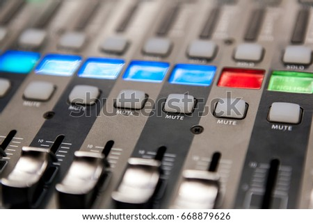 Recording studio equipment. Professional audio mixing console.