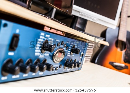 recording studio gears & guitar on background, focus to knob & shallow dept of field for studio music recording concept - stock photo