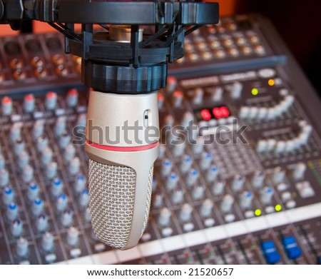 Recording studio microphone over sound equalizer.
