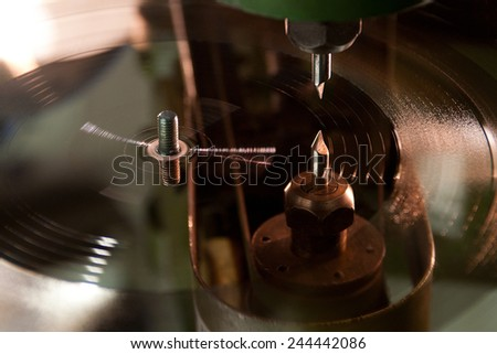 Recording tracks to the vinyl disc form - stock photo