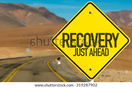Recovery Just Ahead sign on desert road - stock photo