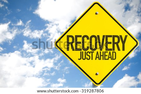 Recovery Just Ahead sign with sky background - stock photo