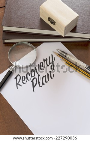 Recovery Plan word written on paper. - stock photo