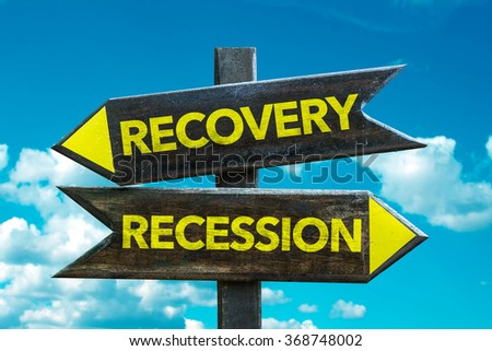 Recovery - Recession signpost with sky background - stock photo