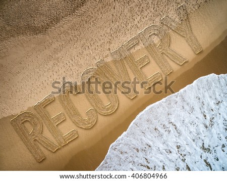 Recovery written on the beach - stock photo