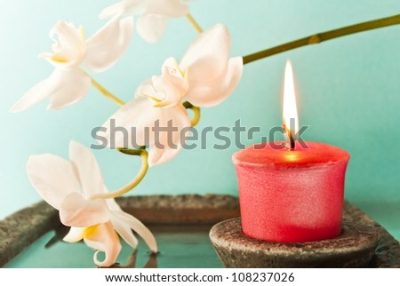 Recreation/ red candle and white orchid flower